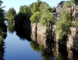 Stone wall overlooking a river